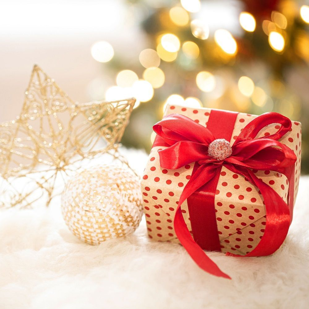 composition-christmas-gift-new-year-s-decoration-light-background-with-gerland-lights.jpg