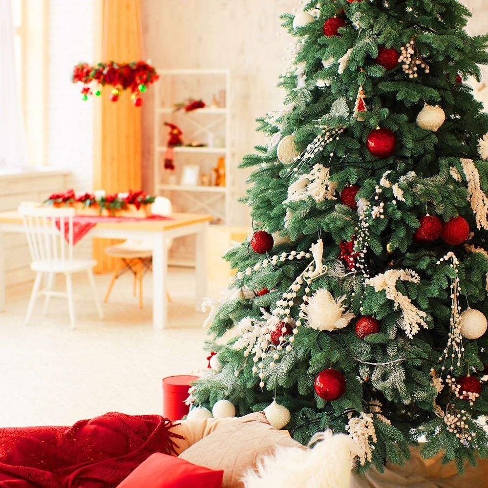 winter-holidays-decor-rich-decorated-new-year-tree-stands-with-present-boxes.jpg