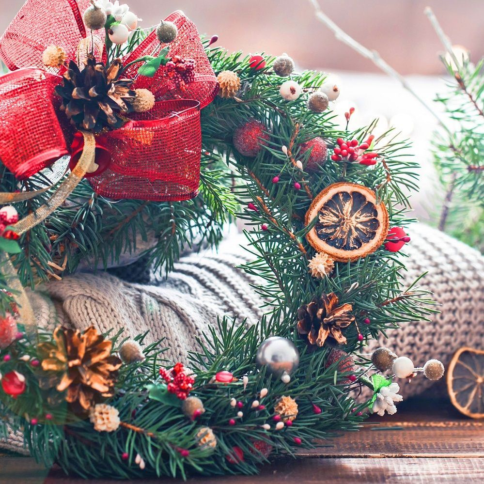christmas-still-life-live-christmas-tree-decorations-festive-wreath-background-knitted-clothes.jpg